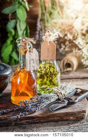 Homemade Tincture In Bottles With Herbs And Alcohol