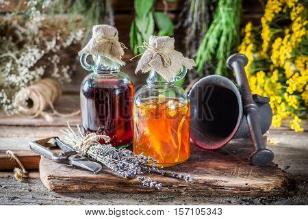 Therapeutic Tincture As An Alternative Cure On Old Wooden Table