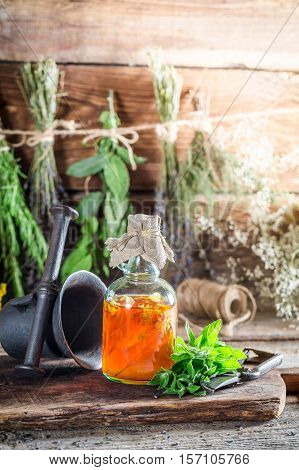 Therapeutic Herbs In Bottles As Homemade Cure