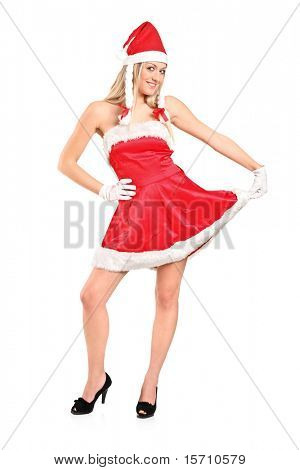 Full length portrait of a beautiful young woman dressed as Santa isolated on white background