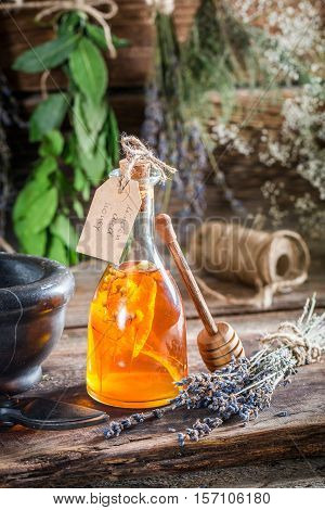 Aromatic Tincture As An Alternative Cure On Old Wooden Table