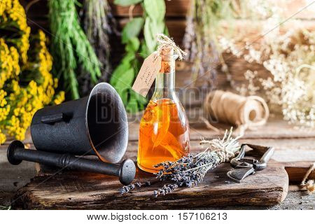 Aromatic Tincture As Natural Medicine On Old Wooden Table