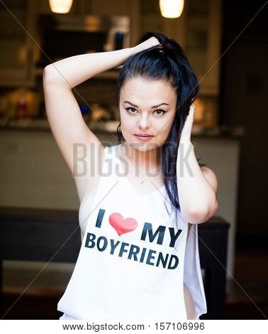 beautiful young woman smiling and exressing love to her boyfriend