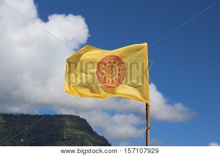 Thammachak symbol on the flag, Flag of Buddhism on sky