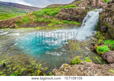 River Flows From A Waterfall In Iceland