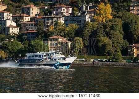Hydrofoil floats on the lake along the shore on Como lake. Seen near Como town 7 November 2016.