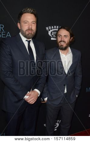 LOS ANGELES - NOV 14:  Ben Affleck, Casey Affleck at the