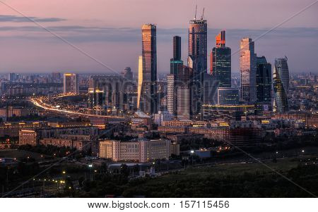 MOSCOW, RUSSIA - AUG 22, 2015: Modern skyscrapers of Moscow City business complex at summer evening. Moscow International Business Center Moscow City includes 20 futuristic buildings