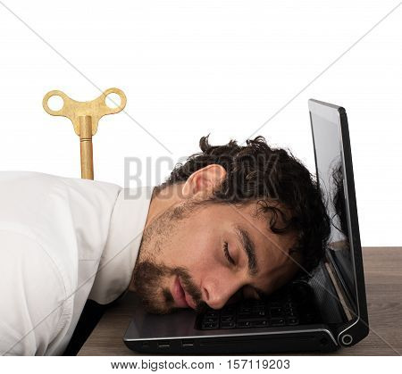 Businessman exhausted from overwork sleeping over computer