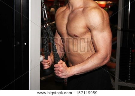 Young man with muscular body, sport object