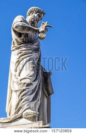 Saint Peter's Statue Holding Golden Key to Heaven in St. Peter's Square in Vatican City