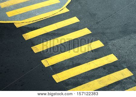 walker stripes pedestrian crossing yellow painted lines on asphalt in the street
