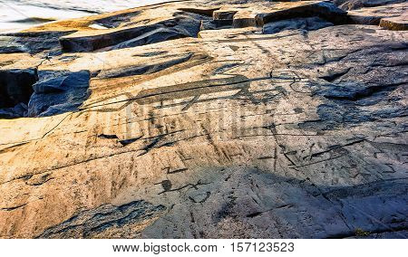 Attraction of Karelia is Onega petroglyphs - prehistoric rock engravings (4th-2nd millennia BC) carved on the granite shore of the lake on the cape Besov Nos.