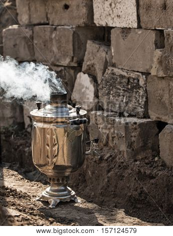 Vintage steaming samovar standing in the open air. Without people.