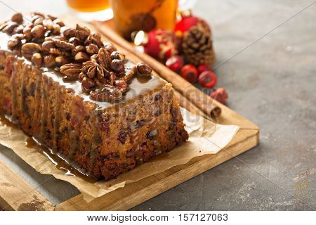 Traditional English steamed pudding with dried fruits and nuts for Christmas
