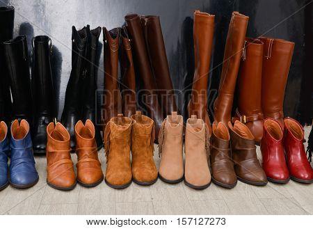 Shoe shop - boots collection on shelves