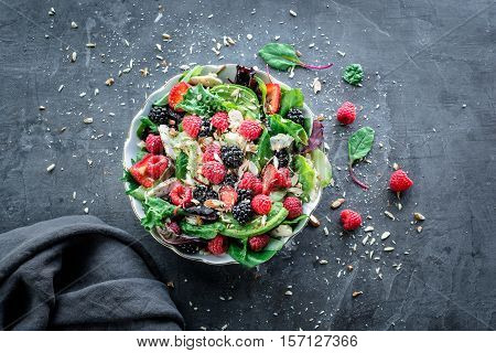summer salad with chicken letuce veggies and mixed fruit