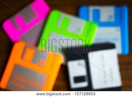 Vintage set of floppy discs on wooden desk bokeh hd