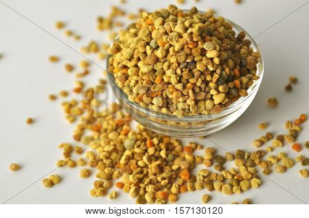 Bee Pollen granules in a glass bowl