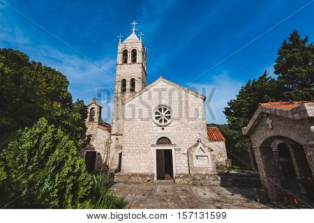 Rezevici abbey is situated between Budva and Petrovac, Montenegro.Stone belfry and facade of The Serbian Orthodox Rezevici Monastery located in Katun Rezevici village near Perazica Do.