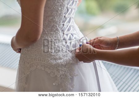 Morning gathering of the bride. Bridesmaid dress, lace-up closure. The concept of the morning of the bride.