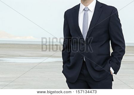 man in suit with salt flats in background