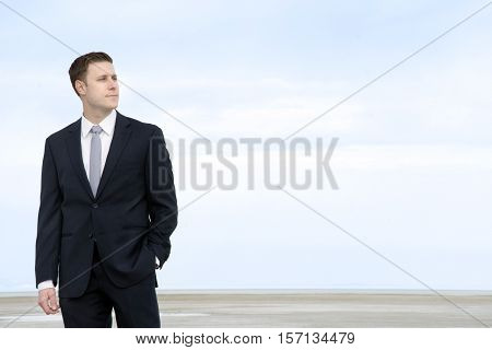 man in suit looks over the great salt lake salt flats