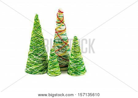 Creative decorative New Year tree of handwork from multi-colored threads