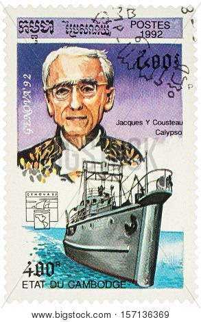 MOSCOW RUSSIA - NOVEMBER 12 2016: A stamp printed in Cambodia shows French ocean explorer Jacques Cousteau and his ship