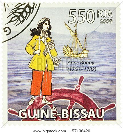 MOSCOW RUSSIA - NOVEMBER 12 2016: A stamp printed in Guinea shows Anne Bonny - an Irish woman a famous pirate in the Caribbean series