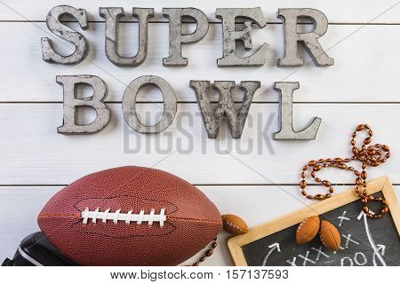 Game day football party table with the words super bowl.