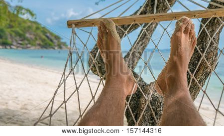 Relax on the Beach in Hammock, Men Foots, Haad Rin Beach, Koh Pangang.