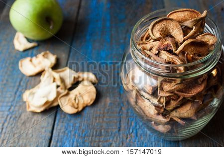 Dried apples and pears in jars. Fruit crisps. Love for a healthy raw food concept