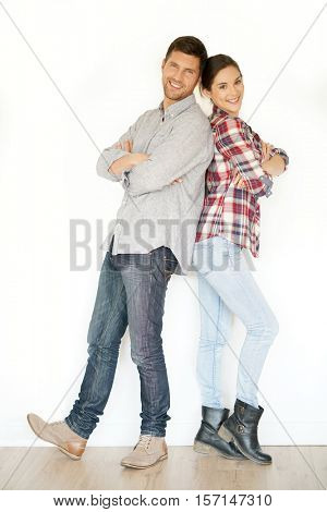Cheerful 30-year-old couple standing on white background