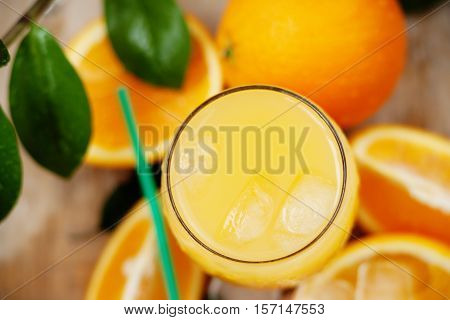 Photography of a orange juice with ice
