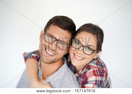 Portrait of middle-aged couple with eyeglasses, isolated