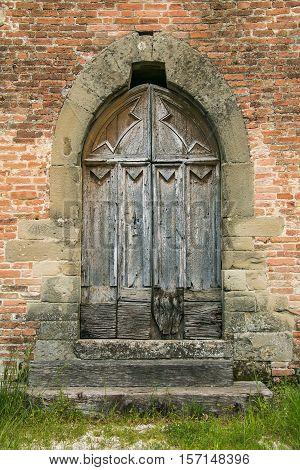 Photo of old wooden Church Door in Italy