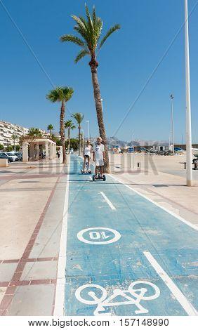 Altea, Spain - September 7, 2016; Segway riders on esplanade cycle-way along waterfront in Altea Spain.