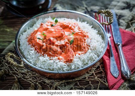 Delicious Tikka Masala With Rice And Tomato Sauce