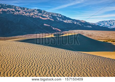 Small ripples of sand orange. Early morning in Mesquite Flat Sand Dunes in California