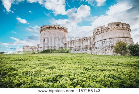 Ruins Of Medieval Old Tower Of Castle Under Blue Sky In Matera Italy