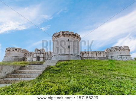 Ruins Of Medieval Old Tower Of Castle With Stairs Under Blue Sky In Matera Italy