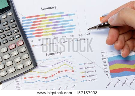 Business meeting man's hands pointing on charts