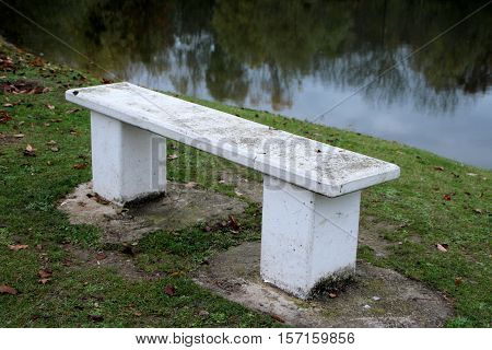 view of a stone bench in a park