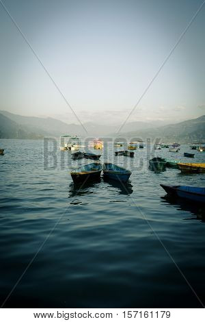 Colorful boats in Phewa Lake in Pokhara Nepal
