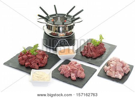 fondue pot in front of white background