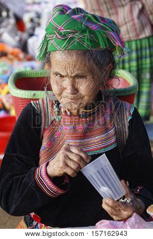 Lao Cai, Vietnam, October 24, 2016 : Woman On A Small Market. Hmong Women Of North Vietnam Wear Thei