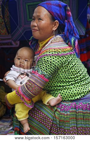 Coc Ly, Vietnam, October 25, 2016 : Baby And His Mother During Tuesday Market Of Coc Ly, A Small Vil