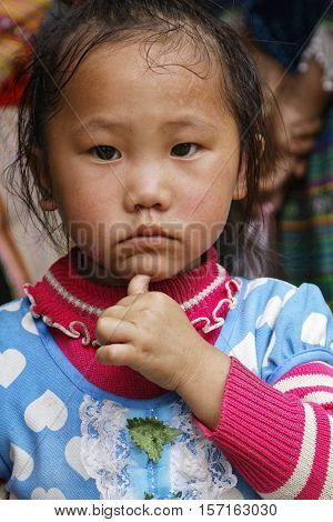 Sin Cheng, Vietnam, October 26, 2016 : Young Girl During Tuesday Market Of Sin Cheng, A Small Villag