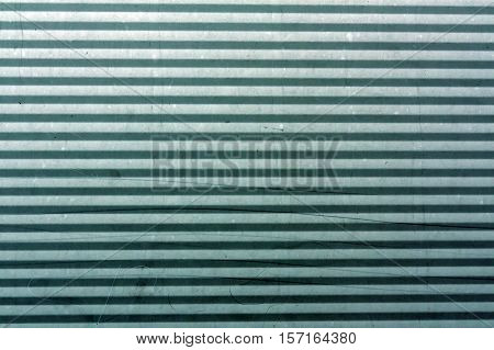 Cyan Toned Corrugated Metal Plate Surface.